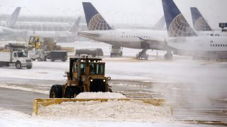 snow plough operating at Chicago O'Hare