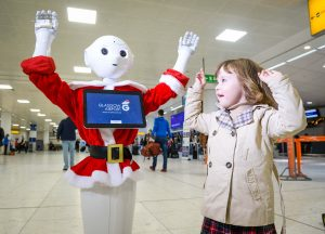 Glasgow has proved once again it has an AI for technology with today's introduction of GLAdys – the UK's first humanoid robot airport ambassador. State-of- the-art GLAdys, whose name comes from Glasgow's International Air Transport Association (IATA) code, will be based in the main departures area and has initially been programmed to entertain passengers of all ages as they pass through the airport. Francesca Collery (3) dances with GLAdys